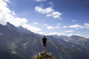 Man at the top of a mountain