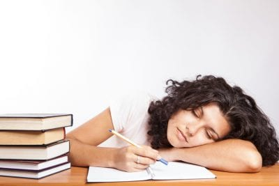 Woman asleep working