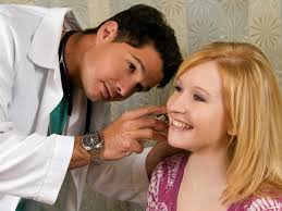 Doctor Performing Ear Inspection