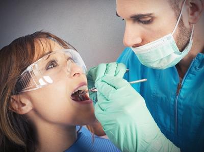 Woman having teeth cleaned