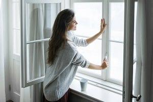 Woman Closing a Window